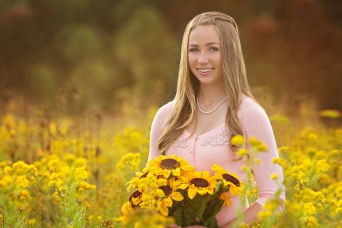 Teen girl in sunflowers