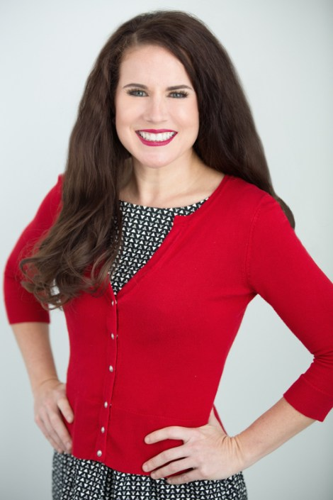 Business head shot of Dr. Allison Berggdoll, Orthodontist, in a dress and red sweater.
