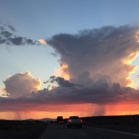Sunset and dual thunderhead in the Mojave Desert