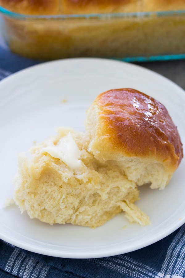 Homemade honey yeast roll on a plate with butter
