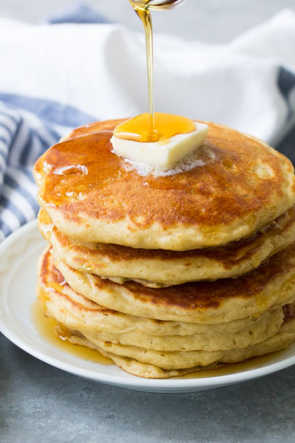 Fluffy buttermilk pancakes with maple syrup. A quick and easy buttermilk pancake recipe with tips for how to make fluffy pancakes.
