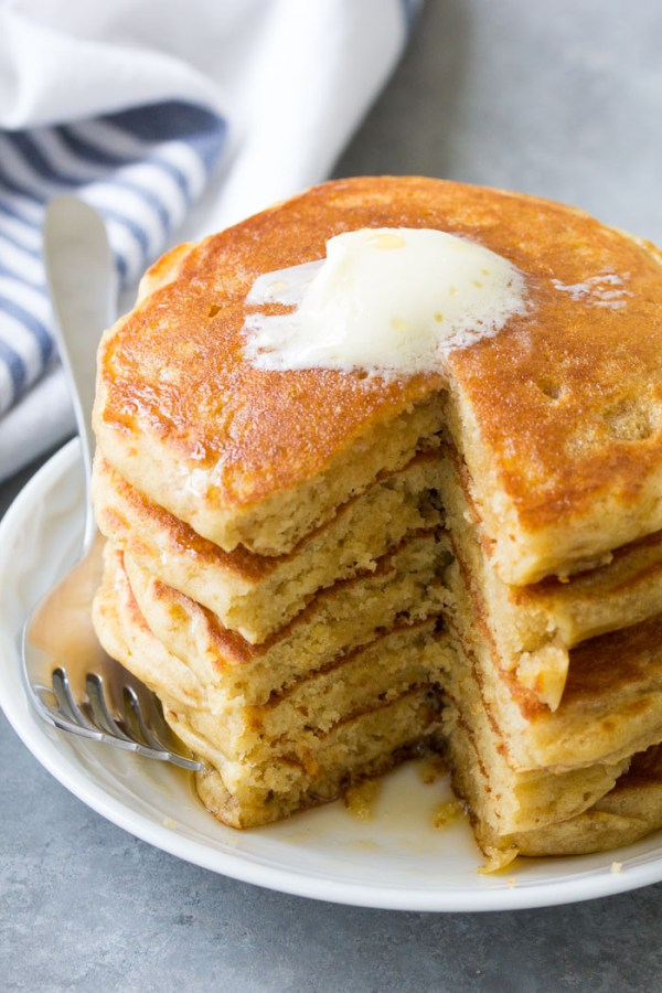 A stack of the best buttermilk pancakes. The pancakes are light and fluffy and made from scratch.