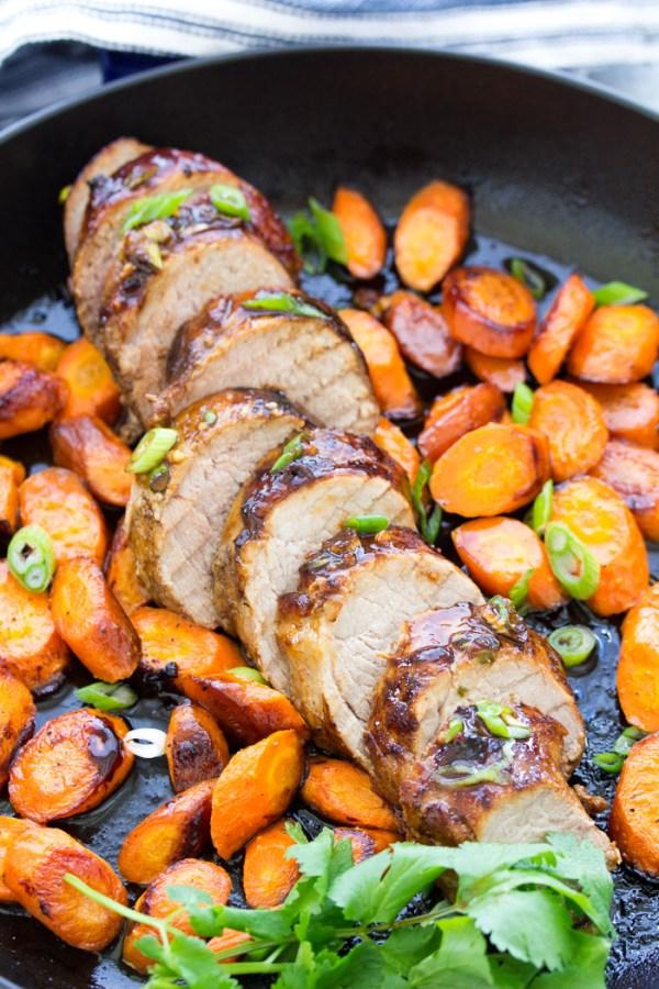 Sliced honey hoisin pork tenderloin with carrots. An easy recipe for oven baked pork tenderloin.