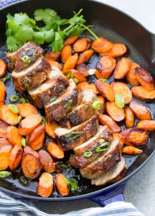 Honey hoisin pork tenderloin, roasted in a skillet with carrots. This pork tenderloin recipe has the most delicous marinade!