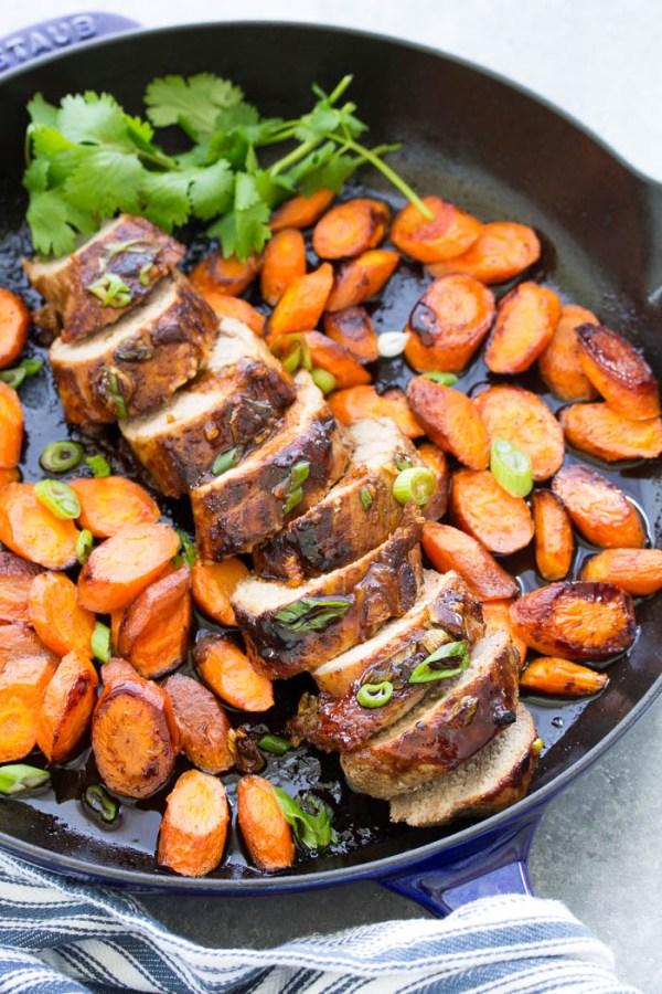 Honey hoisin pork tenderloin, roasted in a skillet with carrots. This pork tenderloin recipe has the most delicous marinade!