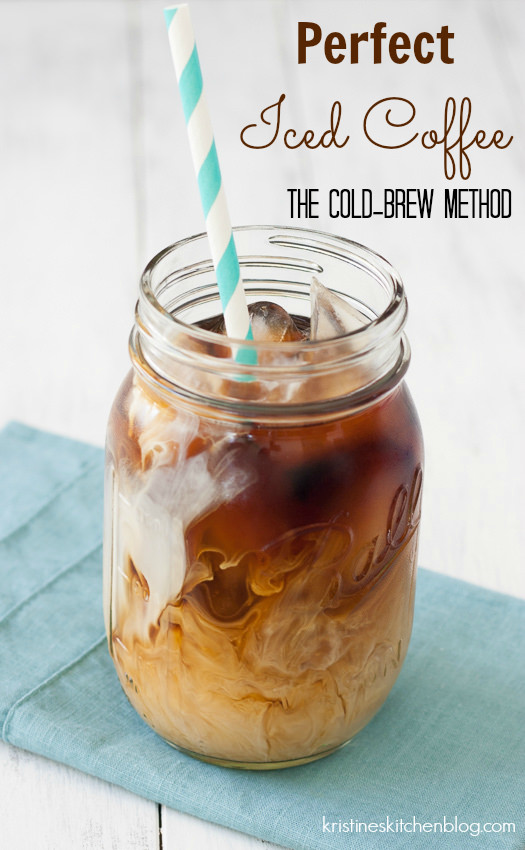 Cold brew iced coffee in a glass with cream.