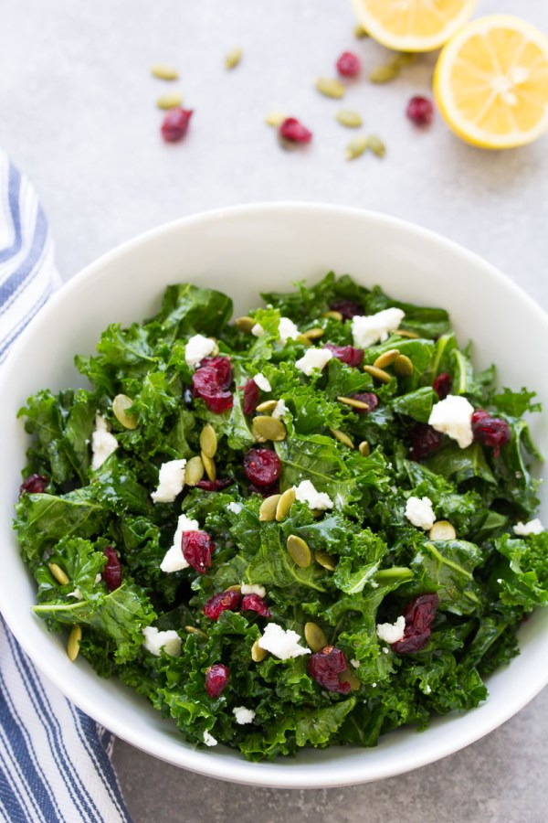 Kale salad with maple lemon dressing in a white bowl.
