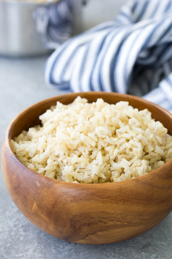 Fluffy cooked brown rice in a wooden bowl.