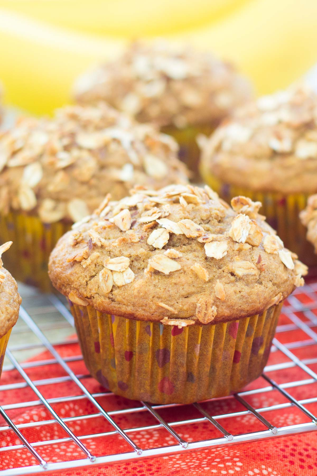 Close up of a banana granola muffin on a wire rack.