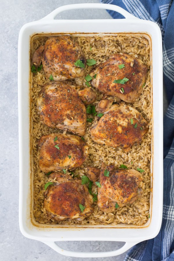 Top down view of baked chicken and rice casserole, made with brown rice and chicken thighs.