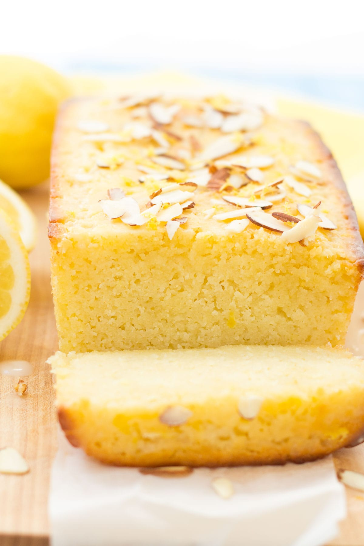 lemon pound cake on cutting board with 1 slice