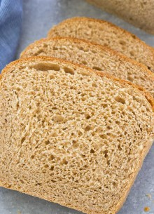Three slices of homemade whole wheat bread.