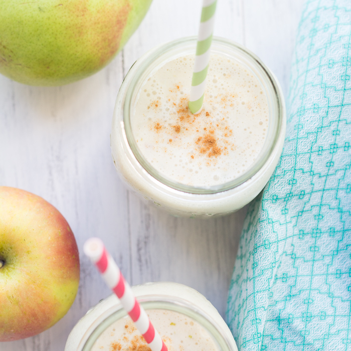 apple pear smoothie in a mason jar with a straw from above