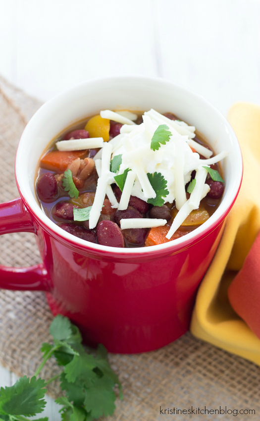 cup of vegetarian chili ready to eat topped with cheese