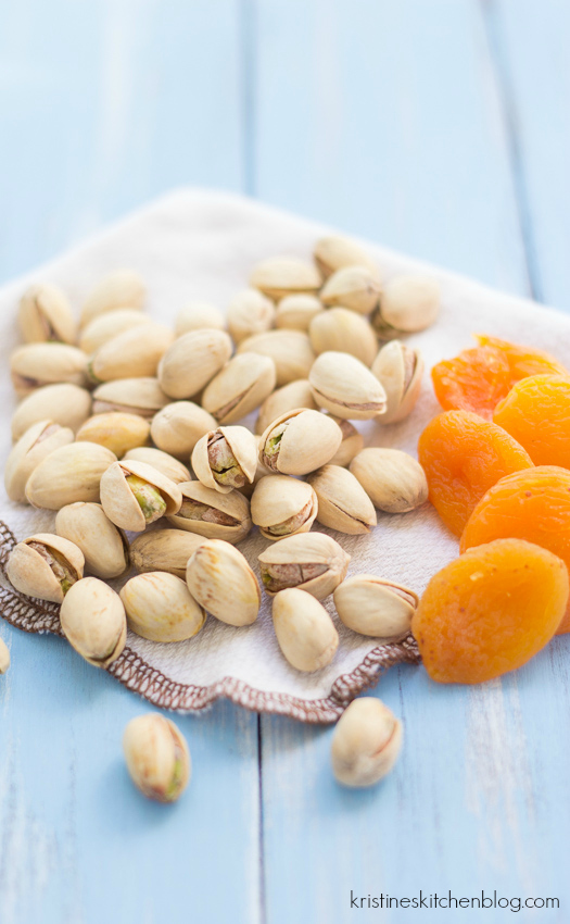 dried apricots and pistachios on a napkin