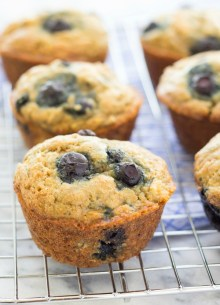 Blueberry banana muffins on a cooling rack.