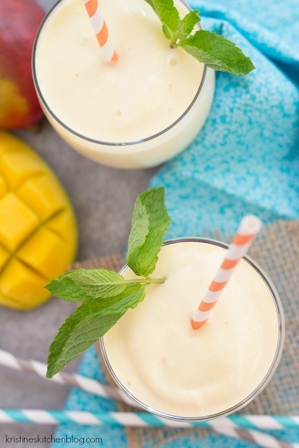 overhead view of mango smoothies with straws