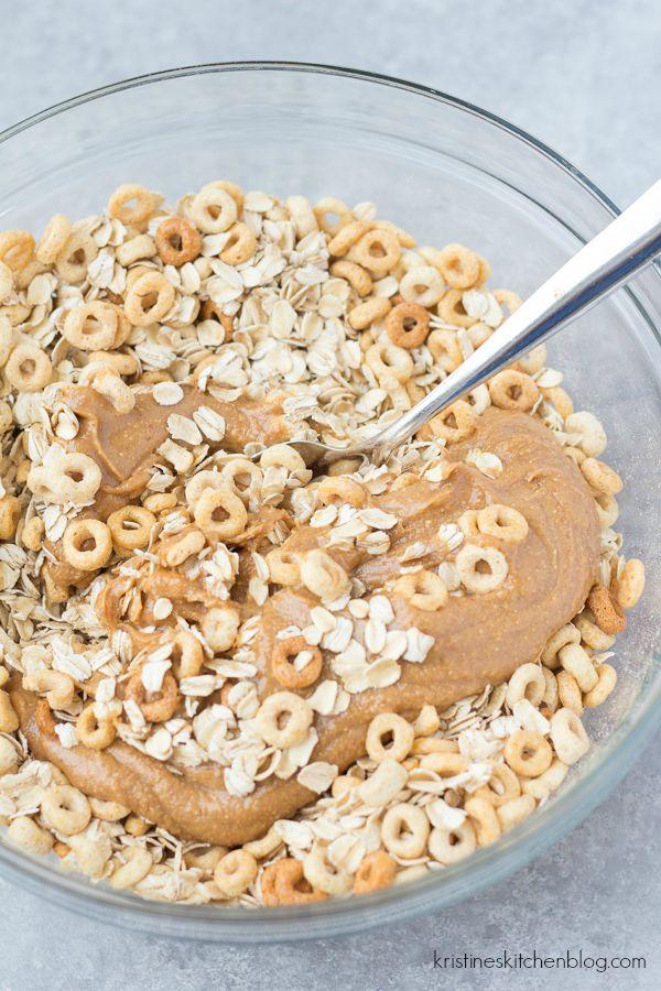 mixing granola ingredients in glass bowl