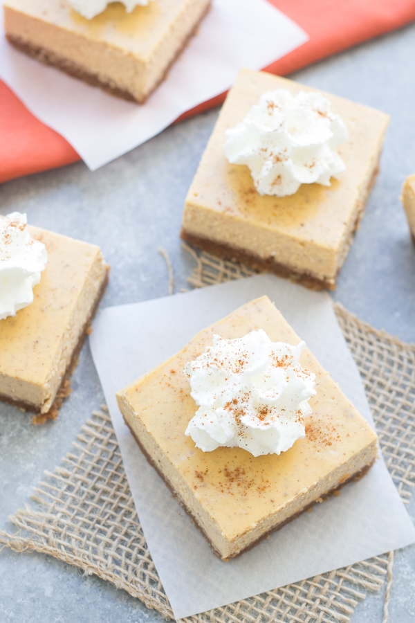 square cut Pumpkin Cheesecake Bars with whipped cream