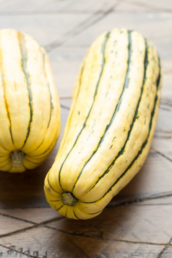 two fresh whole delicata squash