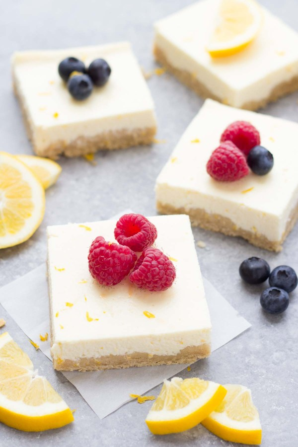 Ultra Creamy Lemon Greek Yogurt Cheesecake Bars! Our favorite easy dessert! These lighter cheesecake bars are made without cream cheese and have a whole wheat shortbread crust. Perfect for Easter or Mother's Day!