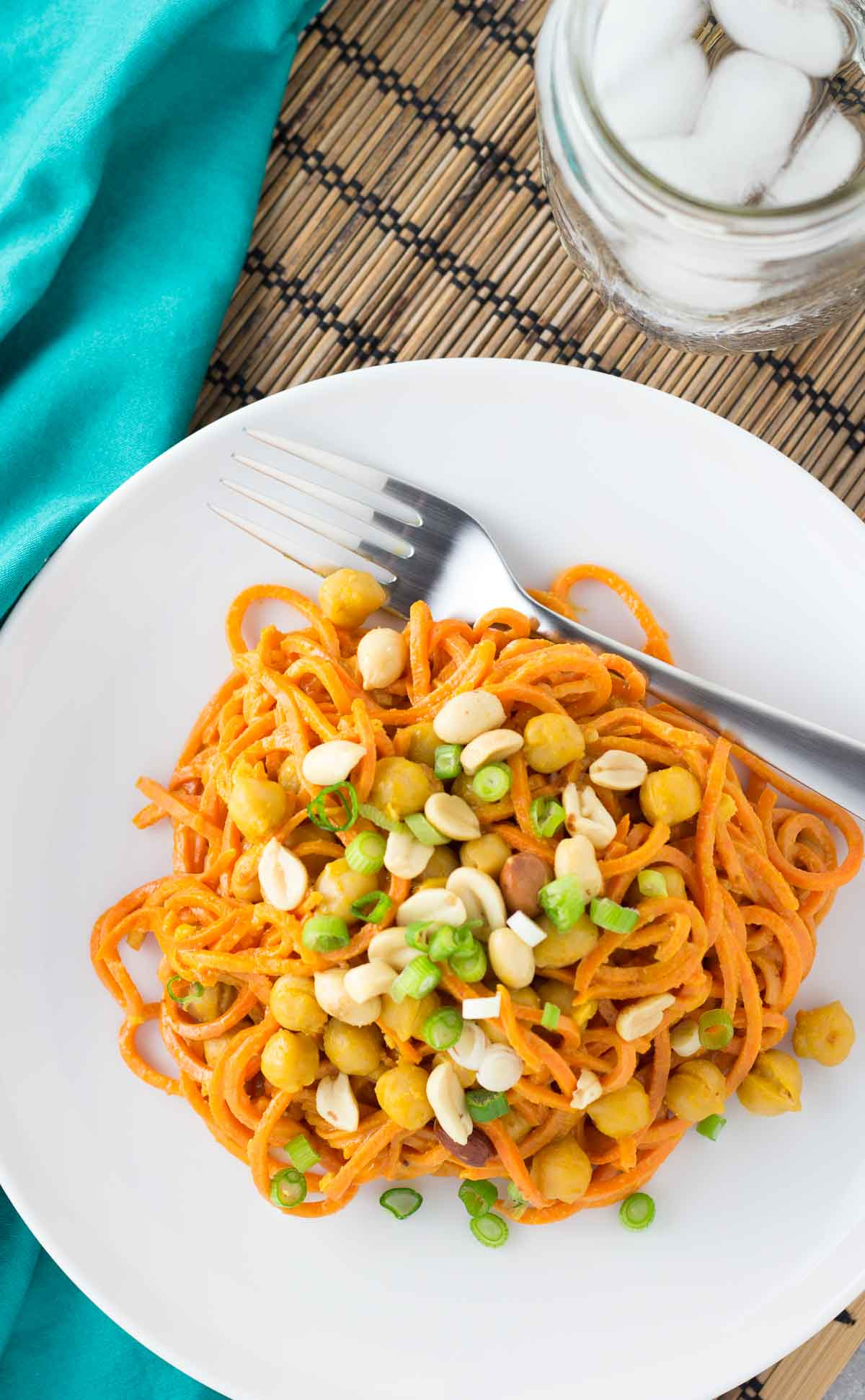 sweet potato noodles on a plate with peanuts and green onions