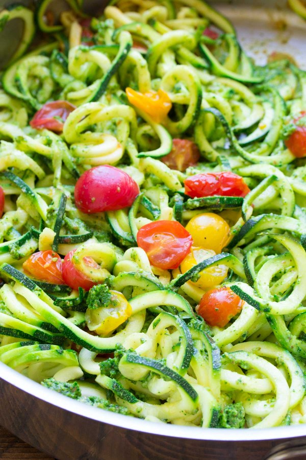 This simple and healthy Kale Pesto Zucchini Noodles and Salmon dinner is ready in just 30 minutes! This zoodles recipe is one of our favorites! kristineskitchenblog.com