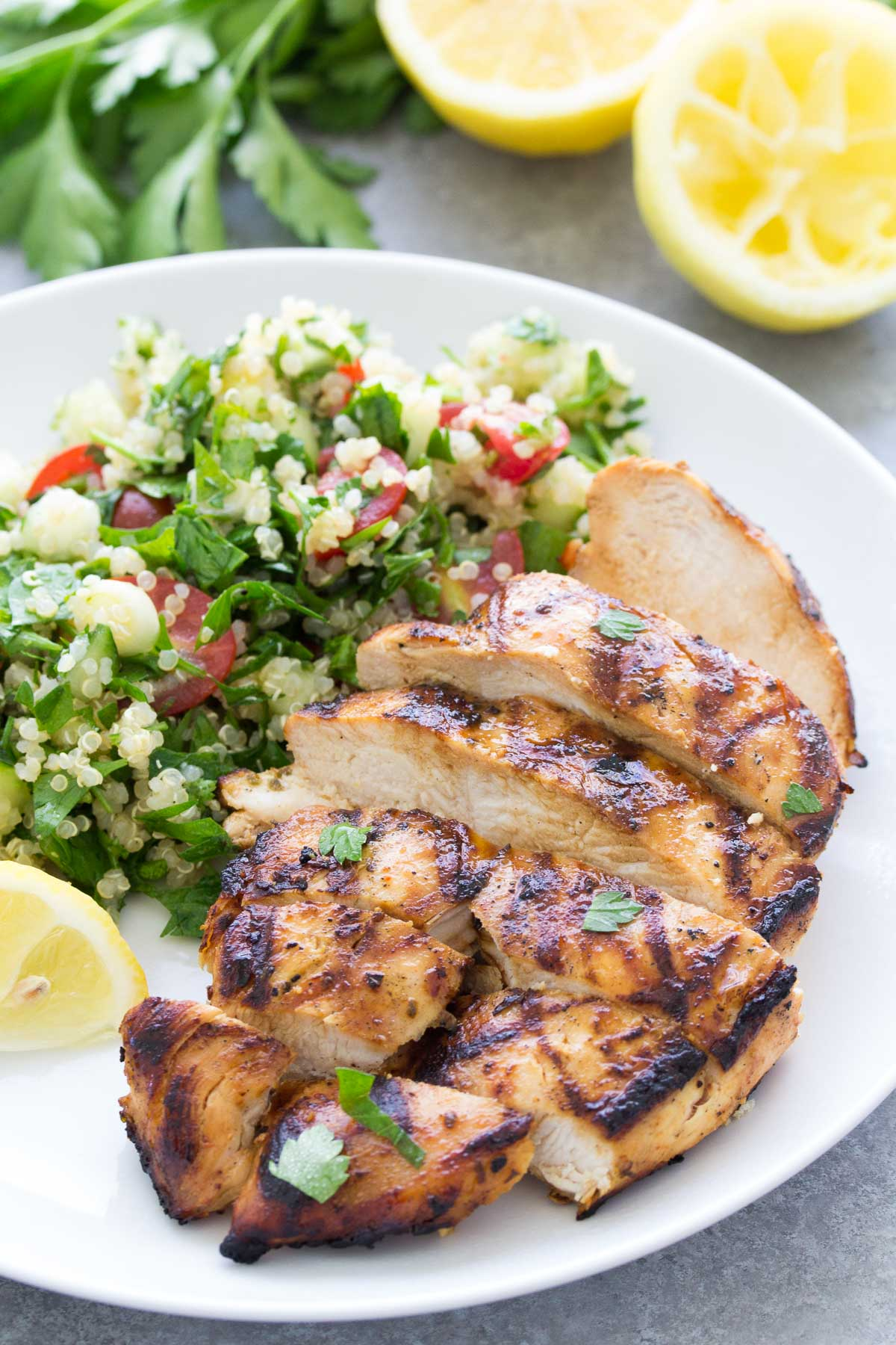 sliced grilled chicken served with salad