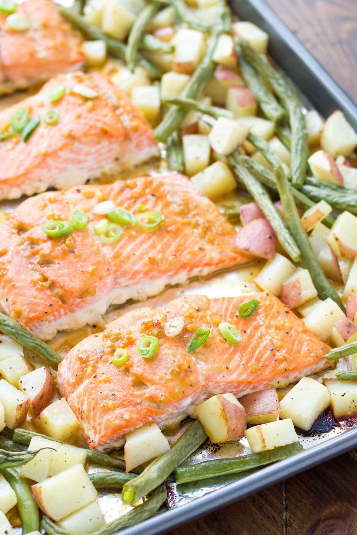 Honey garlic salmon with potatoes and green beans on a sheet pan