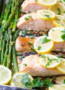 salmon and asparagus with lemon on a sheet pan