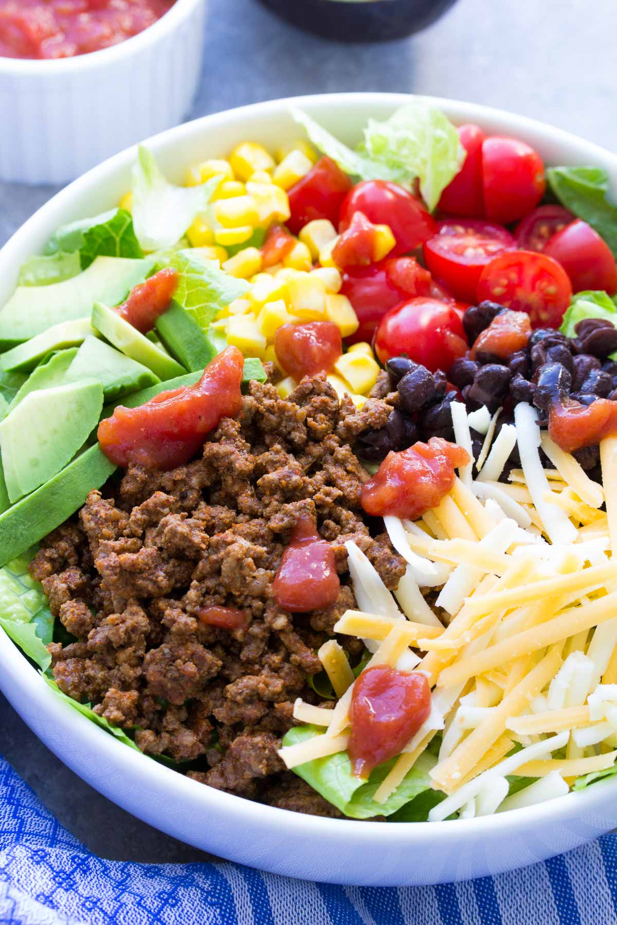 taco salad with ground beef served in a white bowl