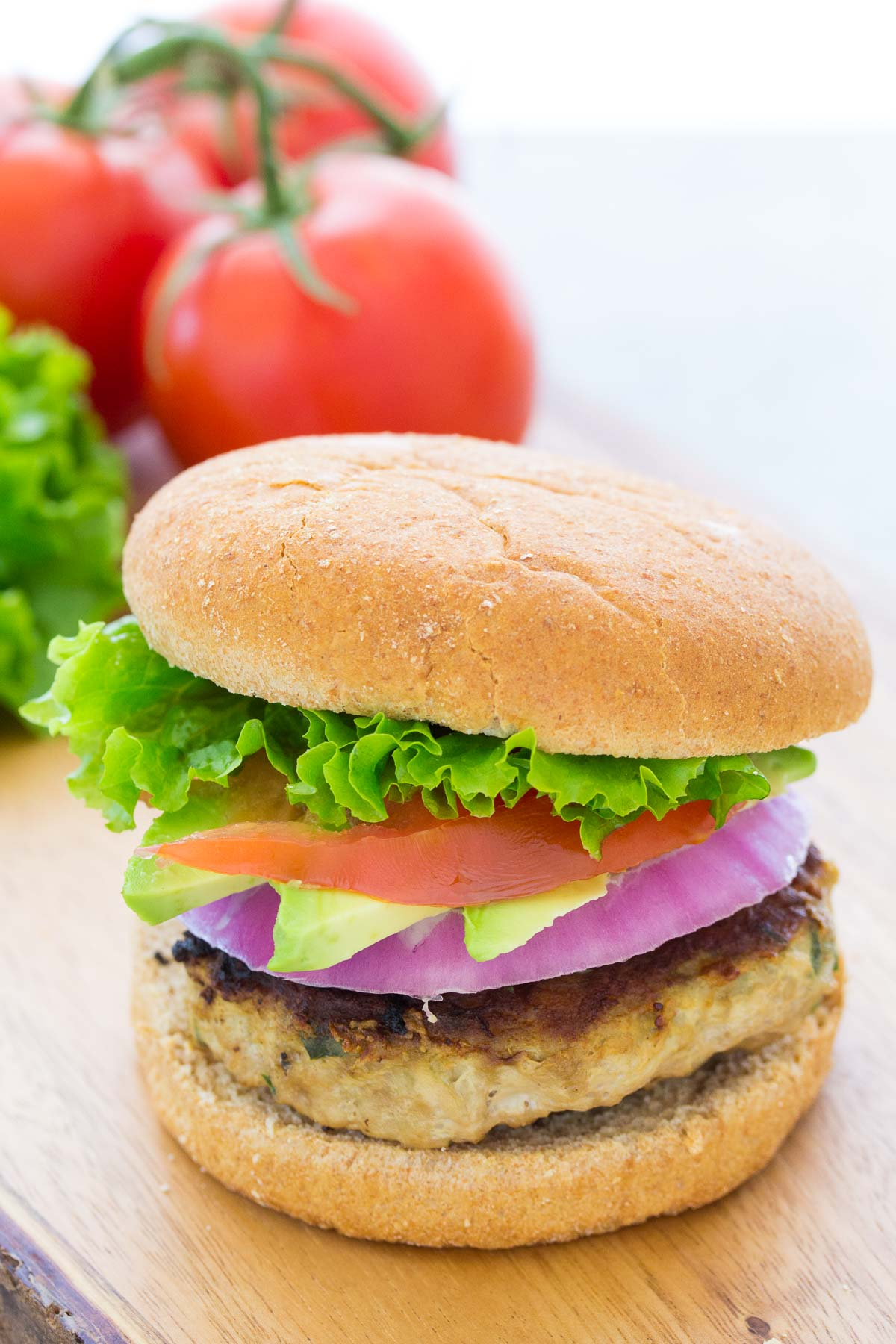 turkey burger with red onion, avocado, tomato and lettuce