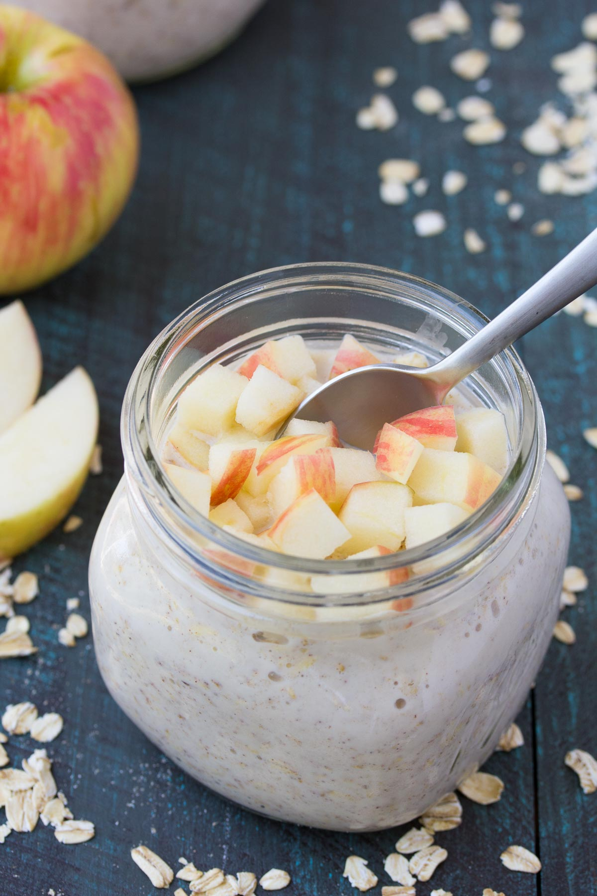 mason jar filled with overnight oats with a serving spoon