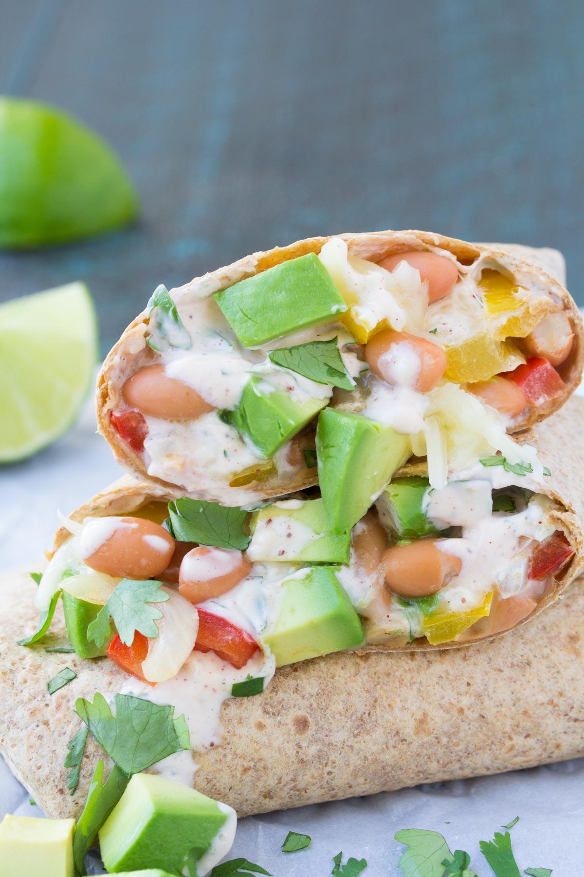 These Creamy Avocado Vegetarian Burritos are a healthy 30 minute dinner recipe! | www.kristineskitchenblog.com