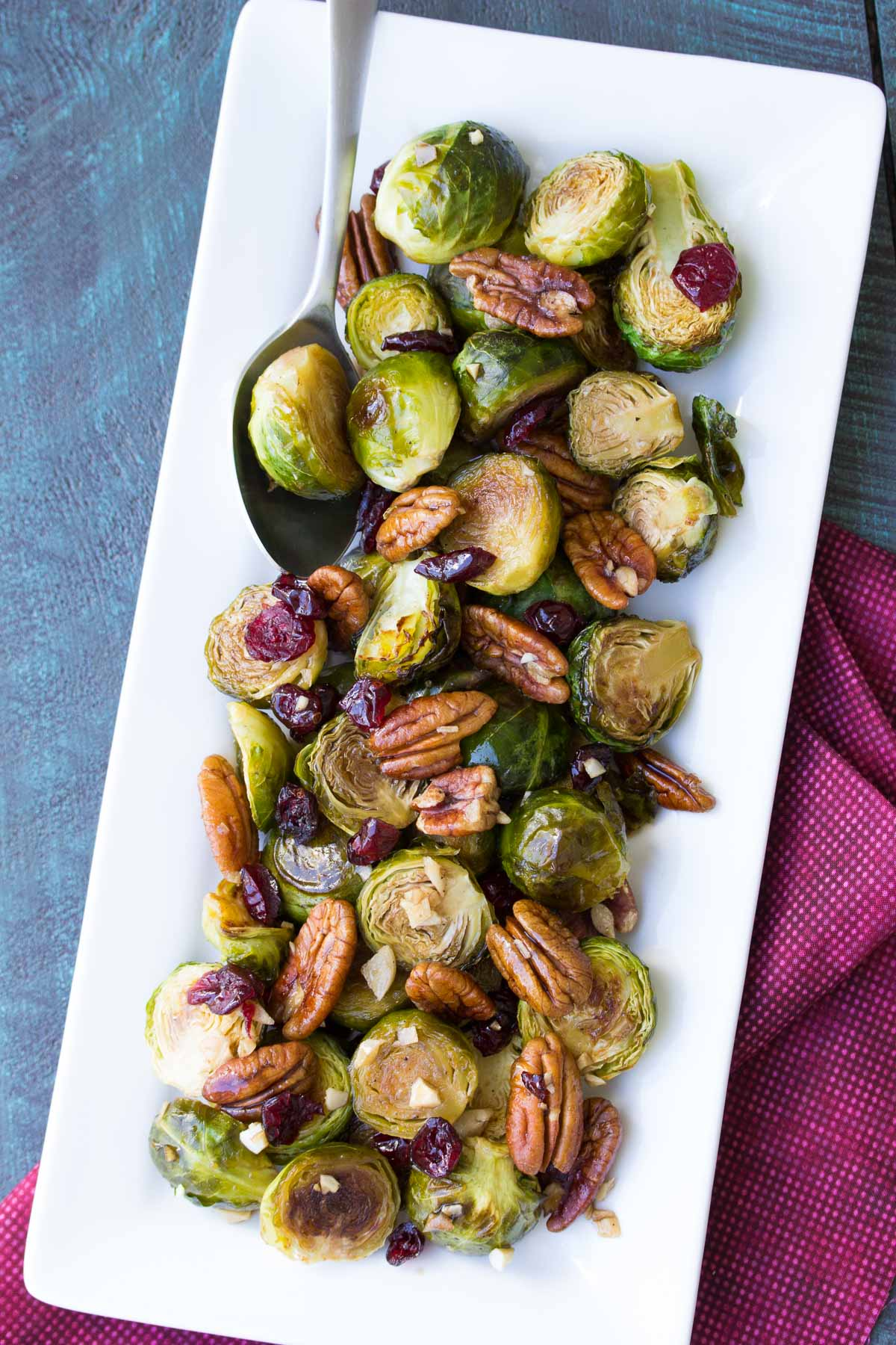 Maple Balsamic Brussels Sprouts with pecans on a serving dish.
