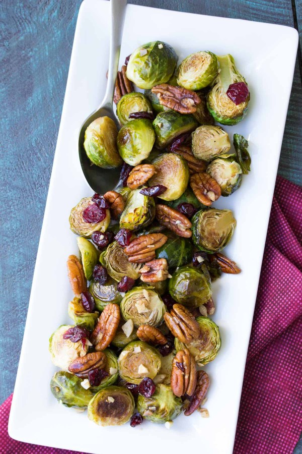 Maple Balsamic Roasted Brussels Sprouts with pecans on a serving dish.