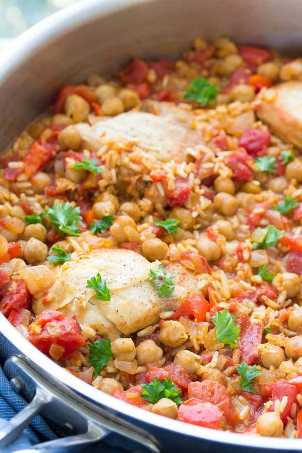 This One Pot Spanish Chickpea Chicken is an easy dinner recipe that the whole family will love! With brown rice, tomatoes, and vegetables, all cooked in one pan! | www.kristineskitchenblog.com