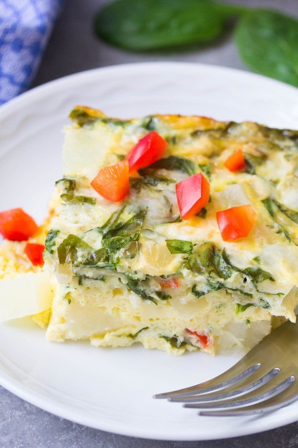 A hearty vegetarian breakfast casserole that's perfect for brunch! This Potato, Spinach and Cheese Egg Casserole is an easy make ahead breakfast. With how to recipe video! | www.kristineskitchenblog.com