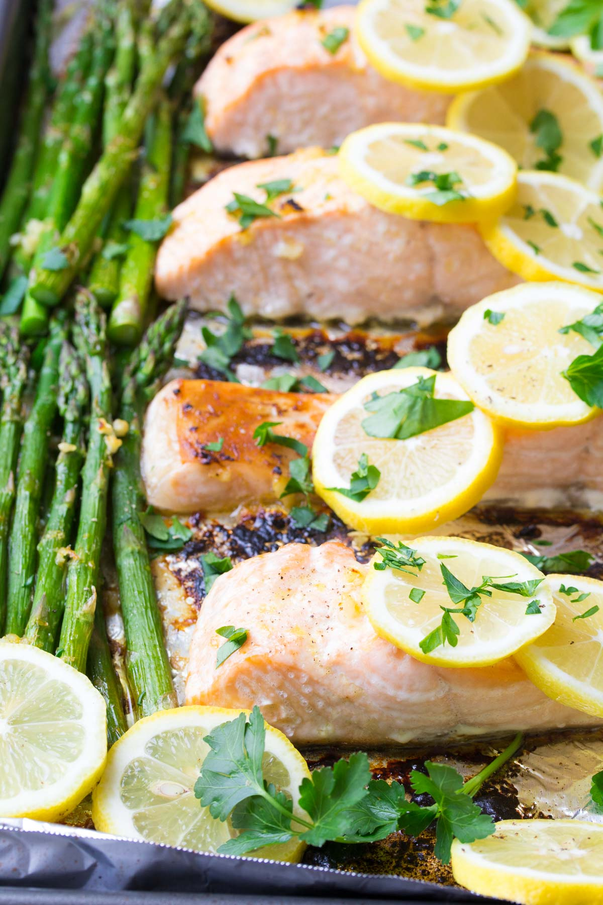 Sheet Pan Lemon Garlic Salmon and Asparagus, ready in 30 minutes! A healthy, easy dinner recipe!   www.kristineskitchenblog.com