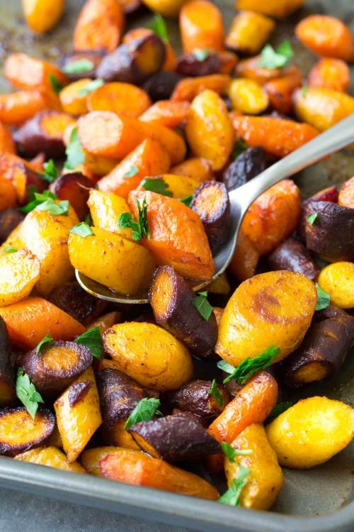 Easy roasted carrots served on a sheet pan.