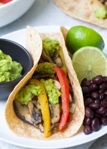 These Vegetarian Portobello Mushroom Fajitas are a 30 minute meal that you can prep ahead! With guacamole, these healthy vegan fajitas are hard to resist! | www.kristineskitchenblog.com