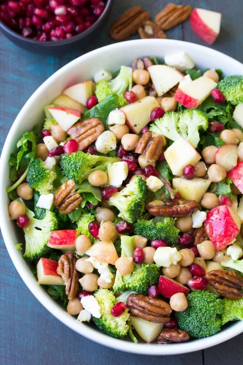 Broccoli kale salad with chickpeas, pomegranate seeds, apple, pecans and feta cheese.
