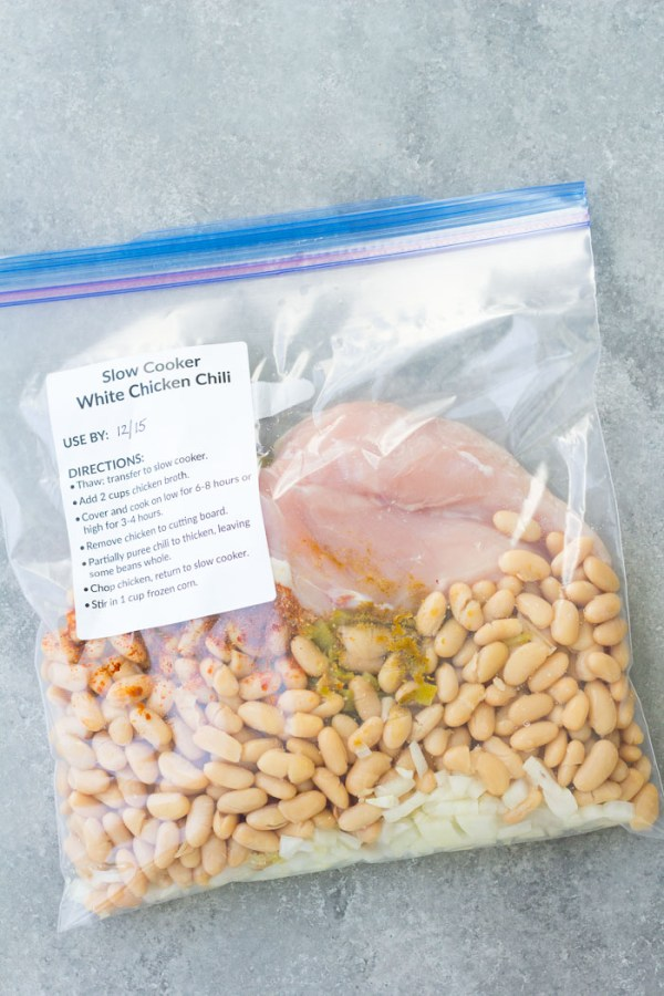 How to make slow cooker white chicken chili as an easy freezer to crockpot meal. This is one of my family's favorite quick prep dinners!