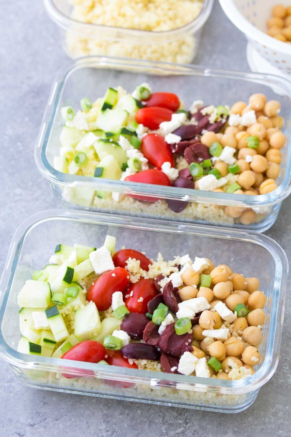 This Meal Prep Greek Couscous Salad is a healthy, vegetarian make ahead lunch. These lunch bowls are filled with healthy vegetables and chickpeas add protein! You can also serve this as a side salad at a BBQ.