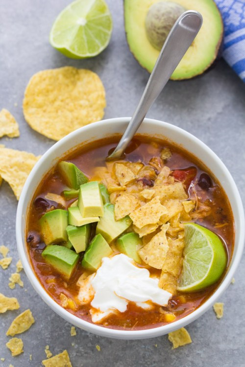 Delicious Instant Pot Chicken Tortilla Soup recipe made with black beans, fire roasted diced tomatoes and corn. This easy chicken tortilla soup can also be made in the slow cooker. It's a healthy one pot dinner recipe!