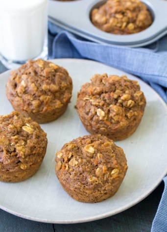 These Healthy Carrot Cake Oat Muffins are a yummy snack for little ones! These muffins are whole grain and refined sugar free. They pack well in school lunchboxes!