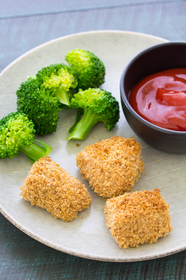 An easy recipe for how to make crispy baked chicken nuggets for kids. Egg free and dairy free. Use either homemade or store bought breadcrumbs. Your kids will love these healthy homemade chicken nuggets! They are freezer friendly - make ahead a big batch for meal prep!
