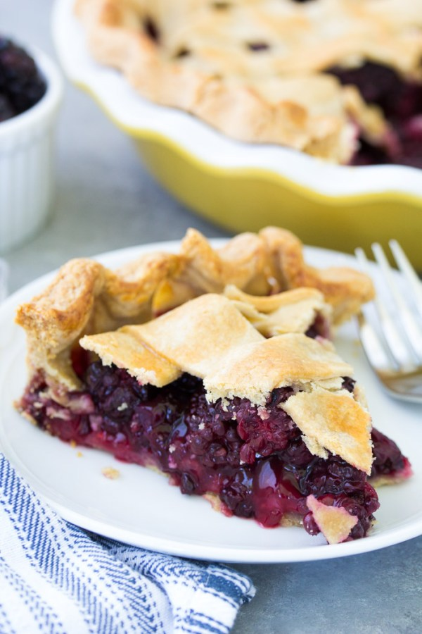 The best blackberry pie recipe using fresh blackberries or frozen blackberries! This blackberry pie filling is sweet and full of juicy berries! Use either my homemade flaky pie crust recipe or store bought pie crust in this easy fruit pie recipe this summer!