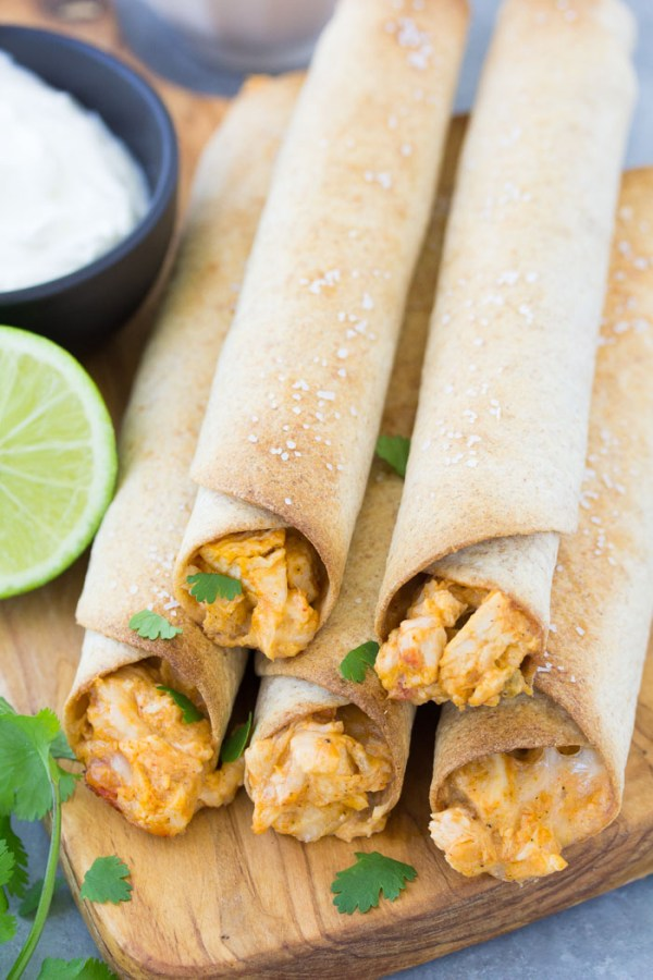 Crispy baked chicken taquitos with a chicken and cheese filling. These taquitos are freezer friendly for quick dinners! The whole family will love them!