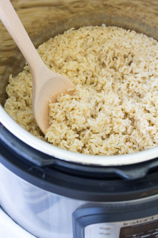 Instant Pot brown rice is a hands off way to cook fluffy brown rice! This easy pressure cooker rice recipe helps to simplify dinner prep!